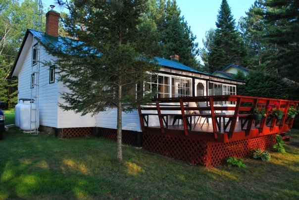 White cottage with red porch