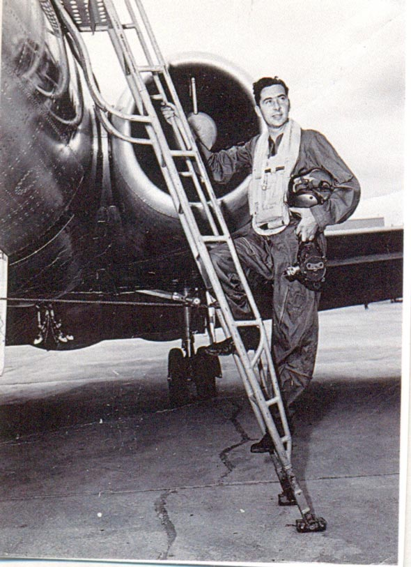 man on a ladder in front of an old timey plane