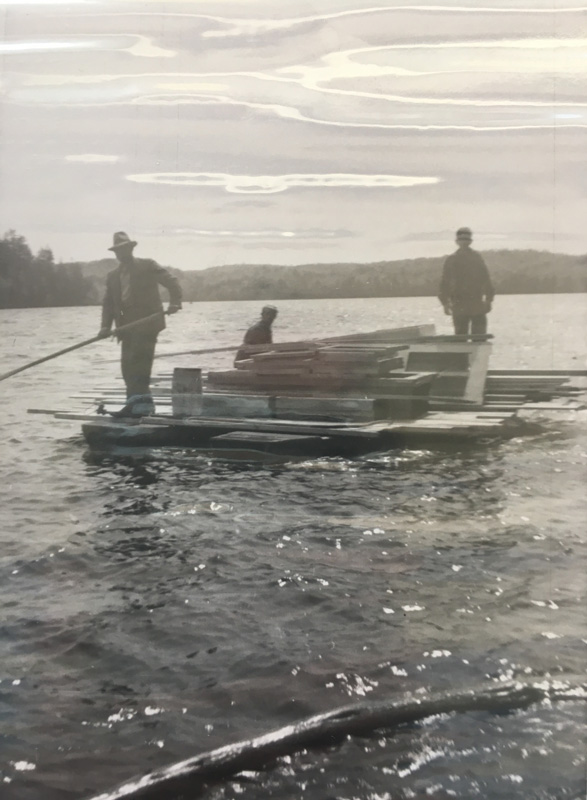 men on a barge in black and white